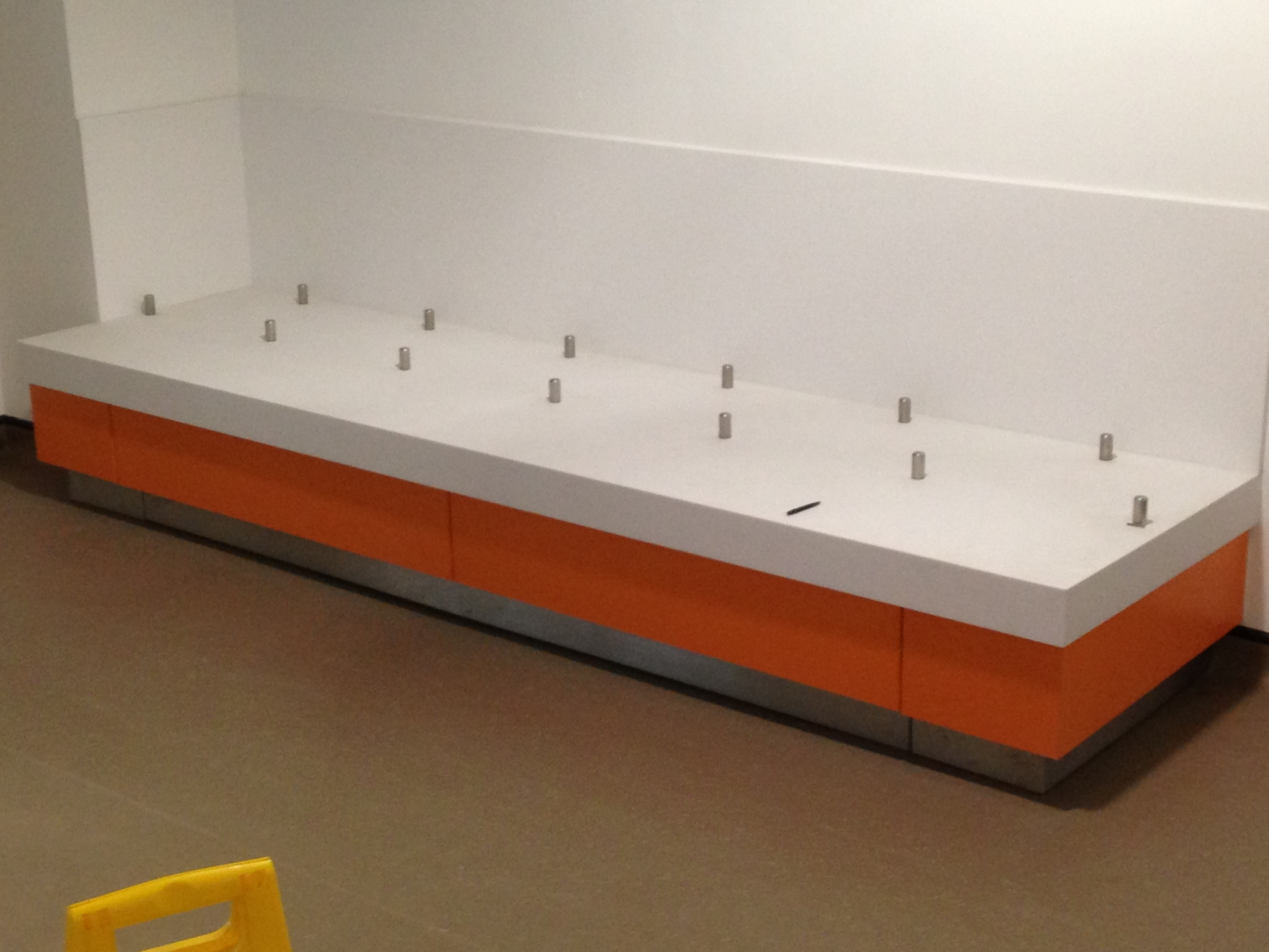 University -  Birmingham White solid surface worktops with stainless steel tray runners and two tone laminated fascia
